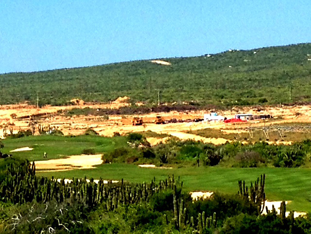 In the foreground are the eighth and ninth holes of the existing Dunes course. The construction and overgrown area are where Woods's course will be built.