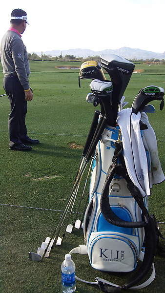 Choi likes to have his irons laid out in a row during his practice sessions.