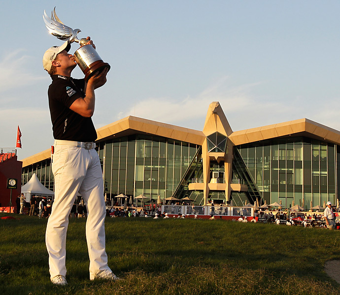 Jamie Donaldson shot a 68 to clip Justin Rose by one shot at the Abu Dhabi Golf Championship.