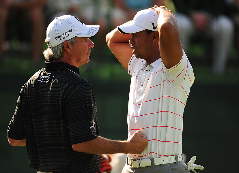 Fred Couples appeared to pump up Woods on Thursday at the Memorial in late June.
