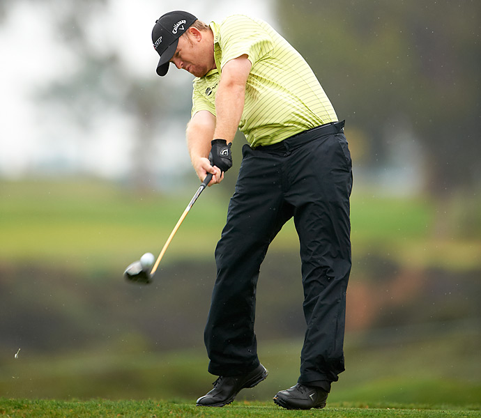 The 2000s: J.B. Holmes                           With a swing more reminiscent of a lumberjack than a golfer, this long hitter from Kentucky has averaged well over 300 yards in driving distance every year since the 2003 season (peaking in '05 with a preposterous 324-yard average). An unusually short backswing and a lot of strength and speed allow Holmes to overpower even the longest courses with the same grip-it-and-rip-it-style popularized by John Daly.