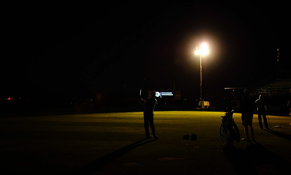 Hunter Mahan was on the range in near darkness before his 7:05 a.m. tee time with Mark Wilson in the first semifinal. Mahan went on to beat Wilson 2 & 1.