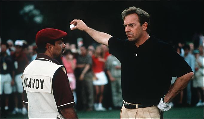 Roy McAvoy and Romeo Posar                                                          During a (fictional) qualifying round for a (fictional) U.S. Open, a (fictional) McAvoy, played by Kevin Costner, starts smashing clubs in frustration, prompting his (fictional) caddie, Posar, played by Cheech Marin, to quit. Seems realistic enough.
