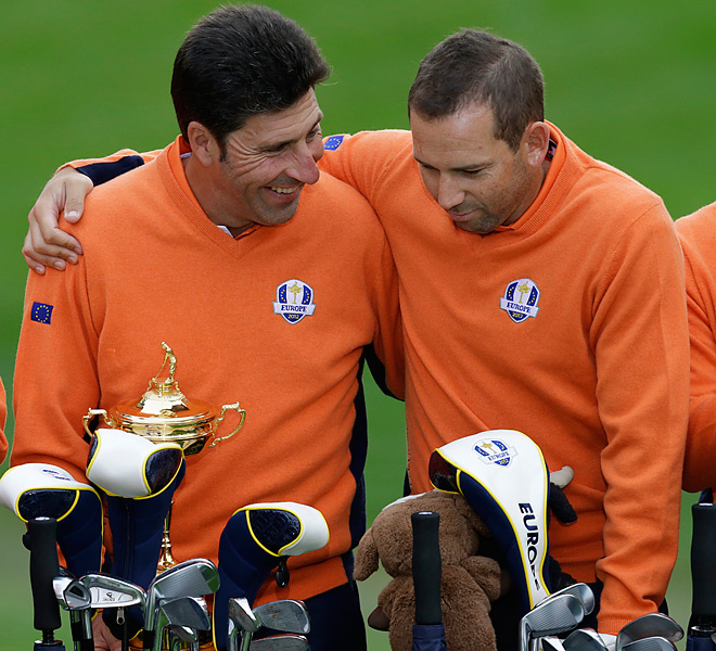 Spaniards Jose Maria Olazabal and Sergio Garcia shared a light moment during the team photo session.