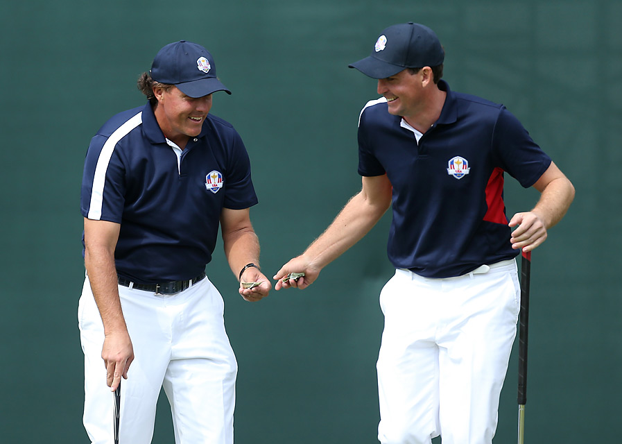 Phil Mickelson and Keegan Bradley figure to be a team in the match-play events. They exchanged some cash during their practice session on Thursday ... but who is paying whom?