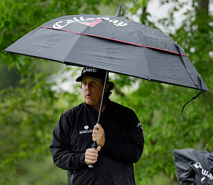 Mickelson and the rest of the field began the round early in the morning to avoid an afternoon storm, but it rained throughout the round.