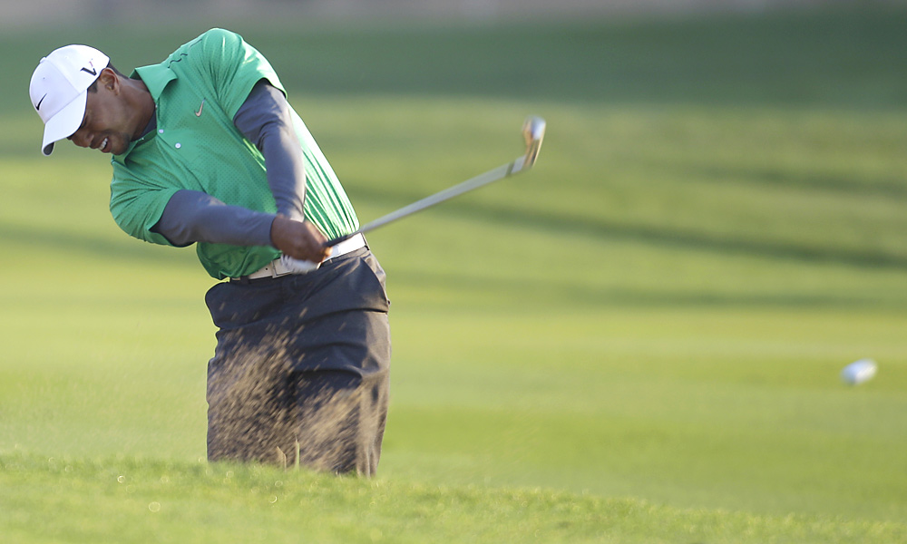 Tiger Woods opened his 2012 season with a bogey-free 70 in Abu Dhabi.