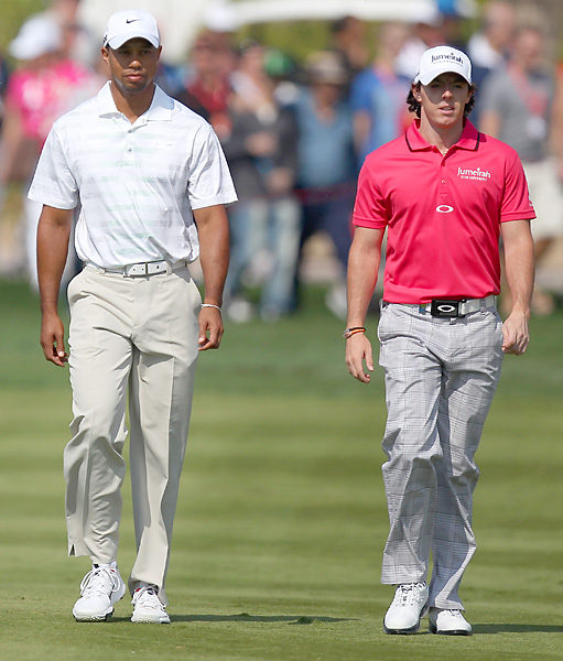 Playing alongside Woods, Rory McIlroy struggled but salvaged an even-par 72.