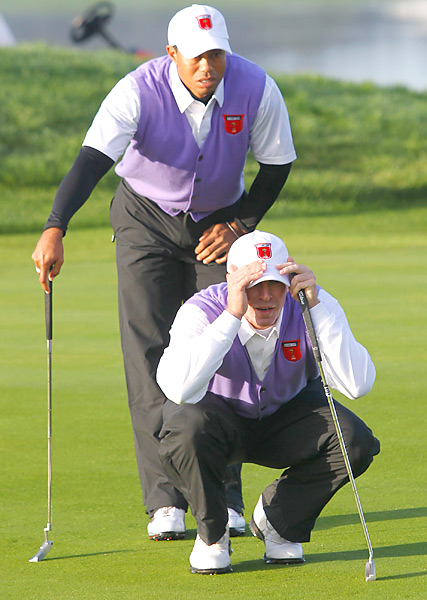 Ruderman says... Hey, I'd look as distressed as Tiger and Steve do if I had to wear an oversize lavender vest too.