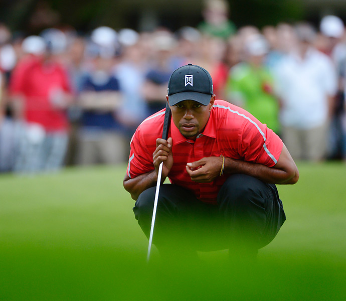 Tiger Woods birdied his second hole of the day to extend his lead to three shots heading into Monday.