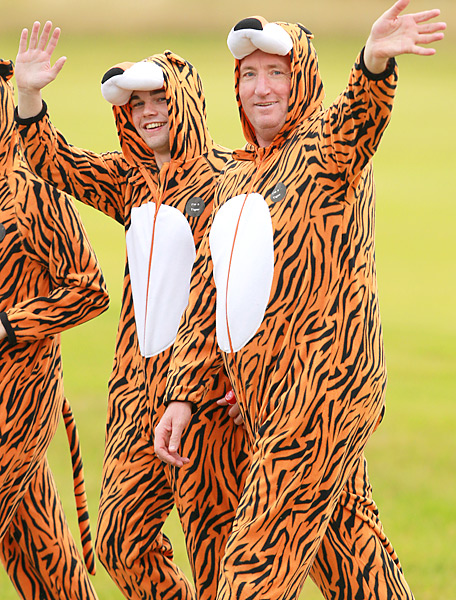 Golf spectators wearing tiger suits waited for Woods during at practice round at the 2012 British Open at Royal Lytham & St Anne's.