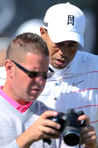 Woods took a break to check the video camera of his coach, Sean Foley.