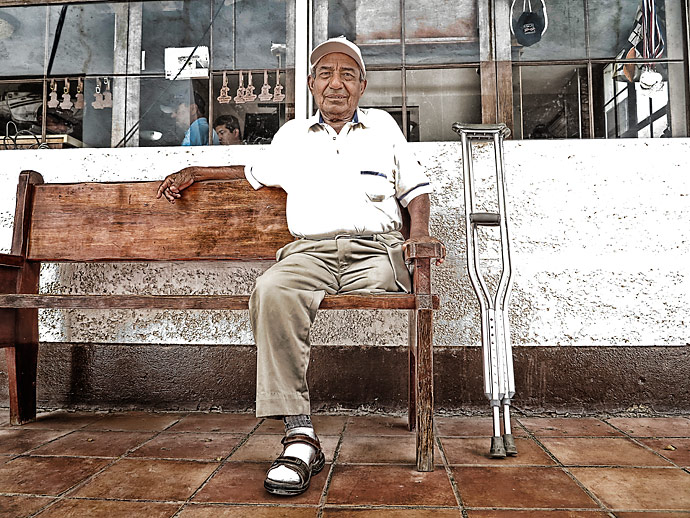 """At age 9, Cruz Contreras began working at Campestre as a ball boy at the tennis courts. At 13, he began caddying, but nine years ago he had his leg amputated because of a clotting problem (his doctor is a member at the golf club). Today the 64-year-old lives alone, but still drives himself to the course three days a week to see his friends. """"Campestre has given me all that I have,"""" he said."""