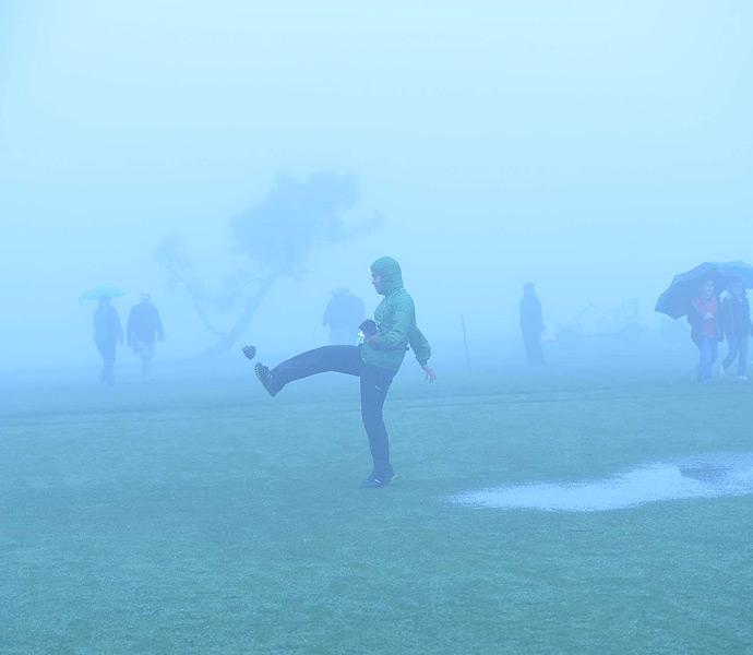 SI photographer Kohjiro Kinno kicked a pine cone somewhere into the mist.