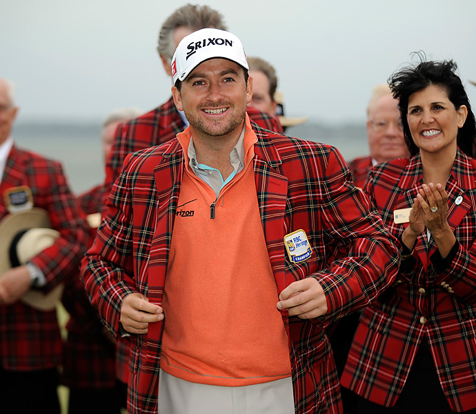 McDowell slipped into the famed tartan jacket after his victory.
