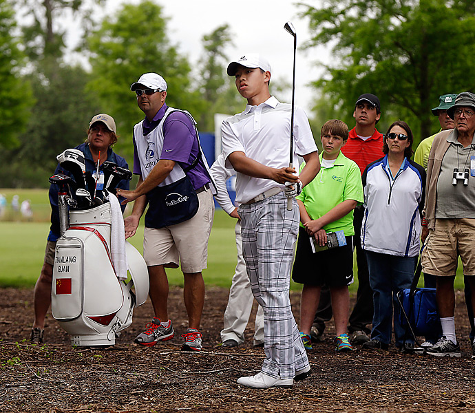 Tianlang Guan, the 14-year-old Chinese amateur who made the cut at the Masters, started his day with a bogey on the first hole (pictured). But he steadied himself and finished the day with an even-par 72