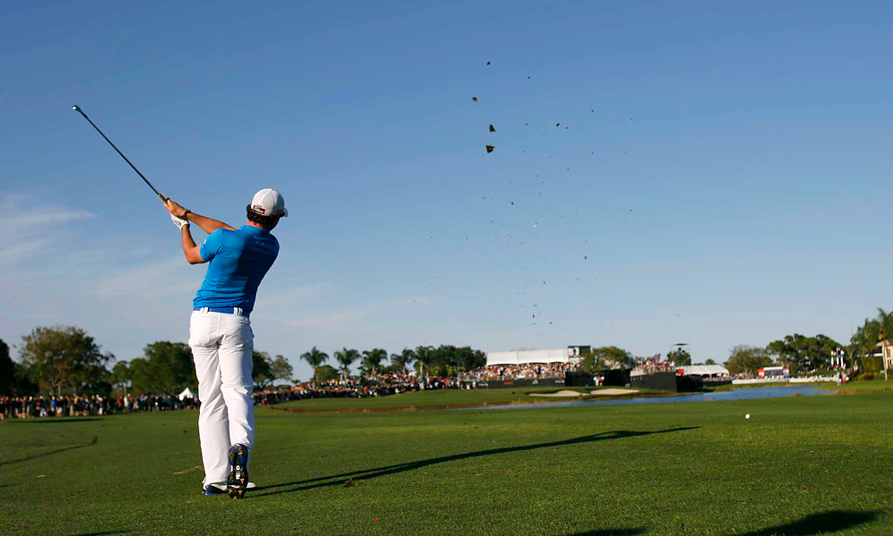 A morning shower eventually gave way to clear skies, and Rory McIlroy's two-shot lead at the start of the round was briefly cut to one by Tiger Woods.