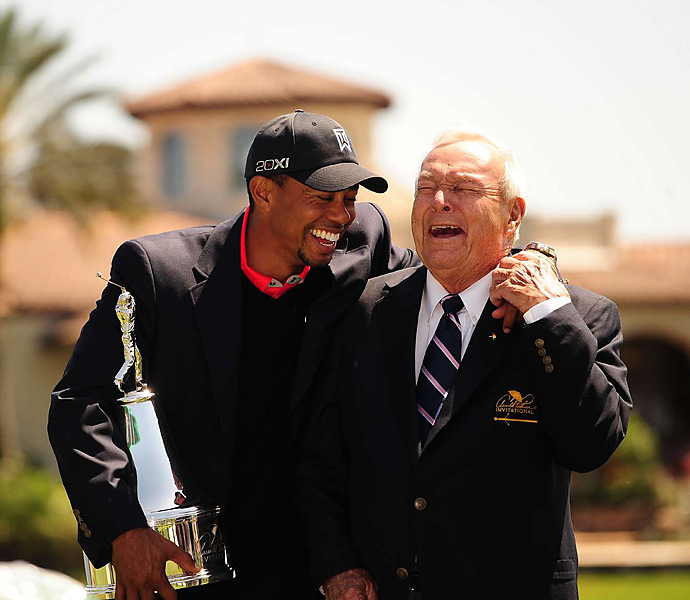 Woods and Arnold Palmer shared a laugh during the trophy presentation. Woods has won Palmer's event eight times, which ties a PGA Tour record for victories at a single event.