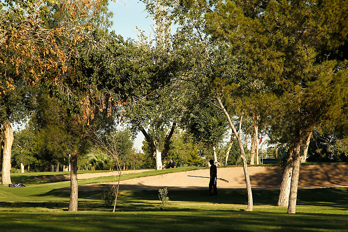 """Campestre's green grass is a source of pride among the maintenance workers. """"To let the greens die is to let our faith die. It's like the cartels won,"""" Viveros said."""
