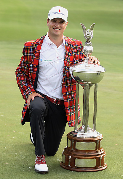 Johnson won both a trophy and the event's famed plaid jacket.