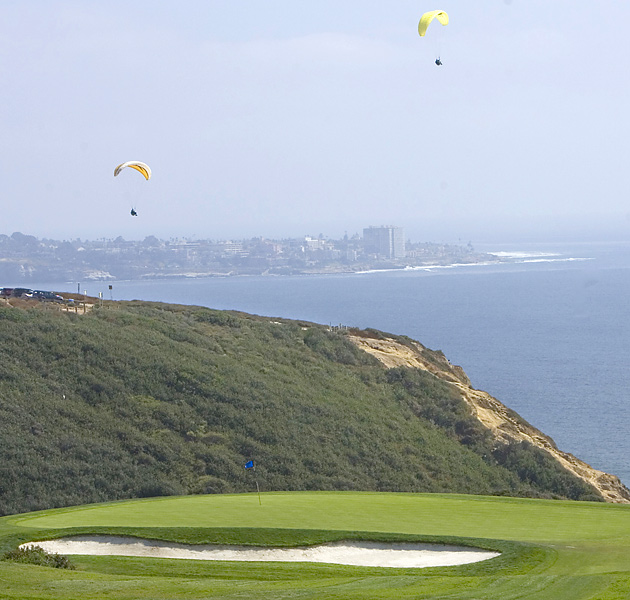 It's common for paragliders to sail over the course during the Farmers Insurance Open, as seen here on hole No. 3 at the 2008 event.