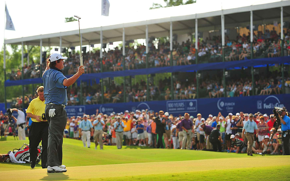 Jason Dufner made a short birdie putt on the second playoff hole to beat Ernie Els (background) and earn his first career PGA Tour victory in 164 starts.