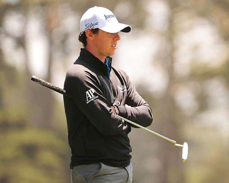 Defending champ Rory McIlroy missed the cut, finishing at 10 over.