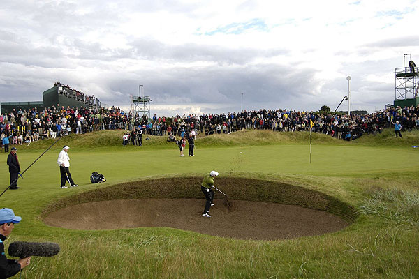 """Rather than shooting a tight shot, I wanted to convey a sense of place with this photo of Sergio Garcia during his playoff with Padraig Harrington in the British Open at Carnoustie. The hill guarding the front of the first green provided a perfect spot for shooting."""