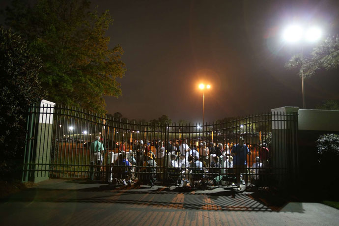Patrons waited at the gates of Augusta National early Thursday morning.