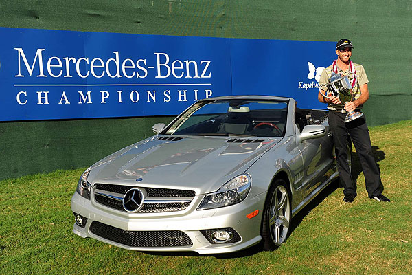 Winning the PGA Tour's season-opening event earned Ogilvy $1.12 million and a new Mercedes-Benz SL550.