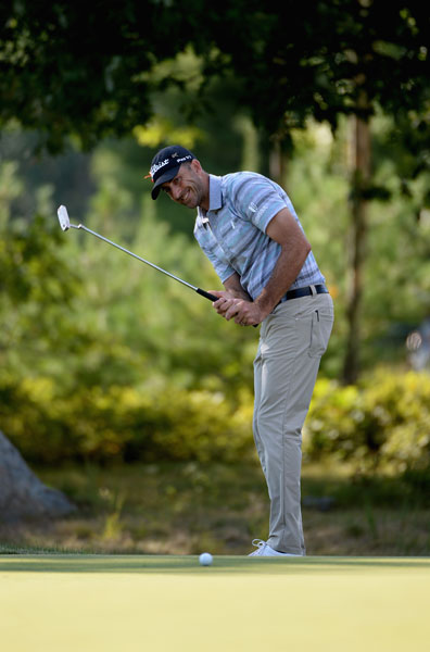 Geoff Ogilvy of Australia fired his second-straight 65 to jump into a tie for second place.