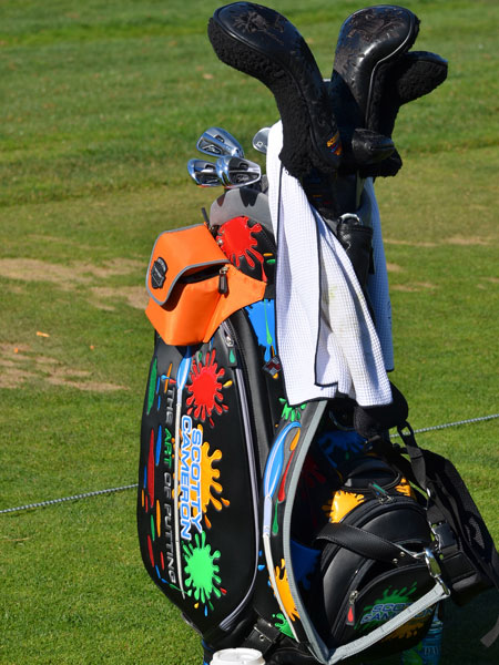 George Lopez is using a paint-splattered Scotty Cameron golf bag again this year at Pebble Beach.
