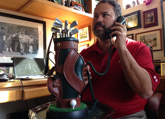 Remember the Bat Phone? This is golf's equivalent. From my expression, it looks like I'm calling headquarters to explain another missed deadline.