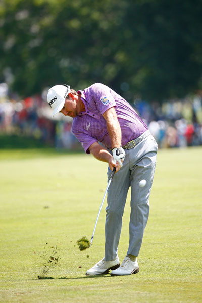 Graeme McDowell shot a 2-under 70 in the third round and was tied for ninth, eight shots back of the lead.
