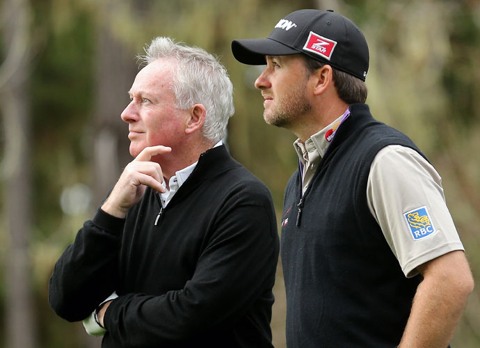 Kenny McDowell (left) and and his son Graeme McDowell of Nothern Ireland look down the 17th hole during the first round of the AT&T Pebble Beach National Pro-Am. Graeme shot 71.