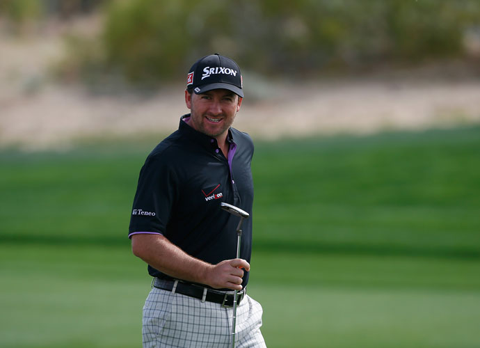 Graeme McDowell of Northern Ireland smiles while playing the second hole of his third-round match against Hunter Mahan. McDowell won the 17th and 18th holes to tie the match and then prevailed, 1 up, in 21 holes.