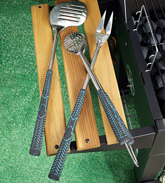 Fore! Golf BBQ Tools Set                       $27.95, homewetbar.com                       Golf and grilling unite with this stainless steel barbecue tool set that features a club-shaped spatula, a divot-fixer-shaped fork, ball-shaped tongs and real golf grips.