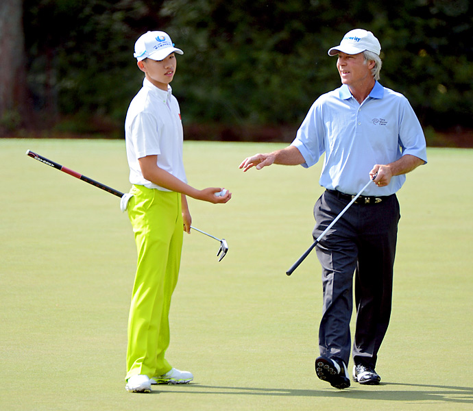 Fourteen-year-old Tianlang Guan, the youngest player ever to participate in the Masters, played a practice round with former Masters champ Ben Crenshaw.