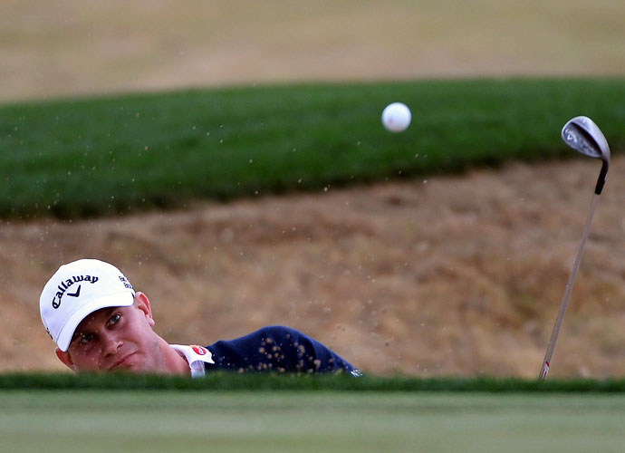 Harris English plays a shot on the 13th hole during the second round of the Waste Management Phoenix Open. English shot 65-67 to get to -10, two shots behind the leaders.