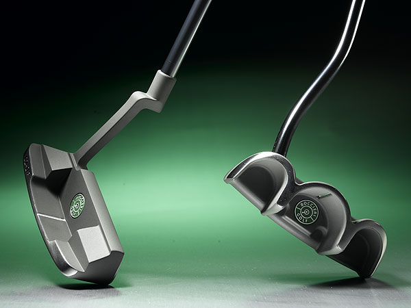 "A heavyweight to knock out three-putts                                                      Heavy DF (for ""deep face"")                           putters stand out from the                           crowd due to a super-heavy                           head that weighs 60 percent                           more than anything else out                           there (the total club weight is                           twice that of any competitor).                           The idea is to promote a ""big                           muscle"" stroke, so the small                           ones in your hands and wrists                           won't flip it or yip it. Models                           such as the C2-DF blade                           (left) or the D3-DF                           mallet (right) measure 1 1/4                           inches from sole to topline.                           Most other heads, including                           earlier ones from Heavy, are                           1 inch tall. Doesn't sound like                           much difference, but the taller                           face raises the club's center of                           gravity (CG). In this case, the CG                           is directly in line with the center                           point of the ball, which sits .84                           inches above the ground. The                           skinny for you should be better                           feel and improved roll.                           $169, steel; heavyputter.com"