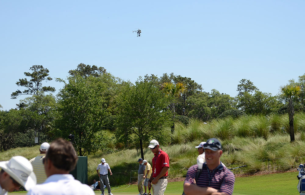 A tiny helicopter carrying a camera buzzed over the practice area on Wednesday, but most pros didn't pay attention to it.