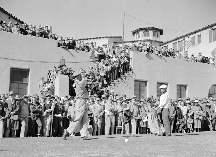 "Ben Hogan takes a practice swing on the first tee during the Los Angeles Open at the Riviera Country Club in January 1950. Nicknamed ""Hogan's Alley,"" the course was the site of Hogan's 1948 U.S. Open victory and three Los Angeles Open wins."