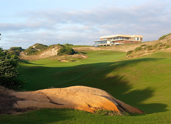 The 18th hole plays to an uphill finish, 489 yards from the back tees. The multi-story clubhouse at The Bluffs features floor-to-ceiling windows, a 100-seat restaurant, men's and women's locker rooms and two large practice putting greens.