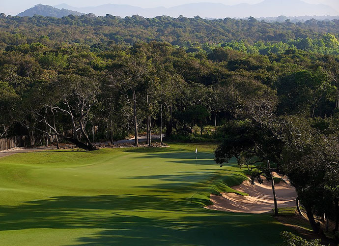 The green on the 376-yard par-4 third hole is framed by some of the lush foliage surrounding the course.