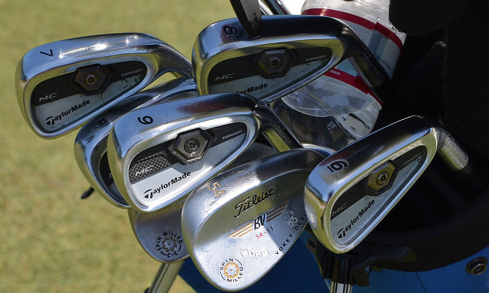 Amateur Beau Hossler uses TaylorMade Forged Tour Preferred MC irons and Titleist Vokey Design Spin Milled wedges stamped WORM.