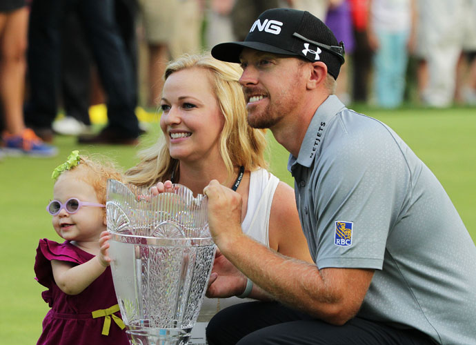Hunter Mahan shot a 6-under 65 at Ridgewood Country Club on Sunday to secure a two-shot victory at The Barclays over Jason Day, Cameron Tringale and Stuart Appleby. Here, he poses with the trophy alongside his wife, Kandi, and daughter, Zoe.