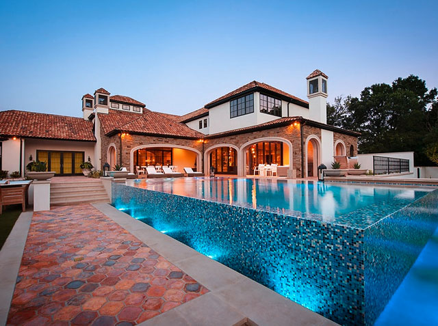 You can escape the Dallas heat in the house's tiled infinity pool.
