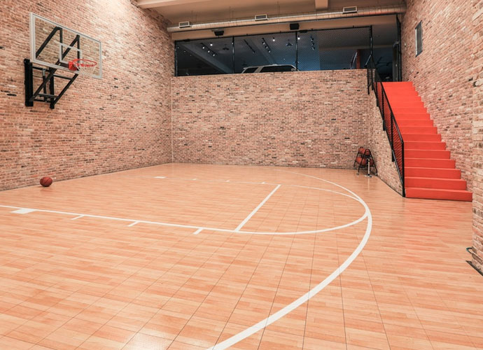 You can shoot hoops downstairs from the garage in this basketball court.