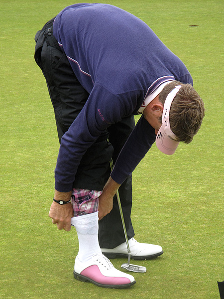turned his pink tartan trousers into makeshift plus-fours when he tucked them into his socks under his rain pants on Thursday morning.