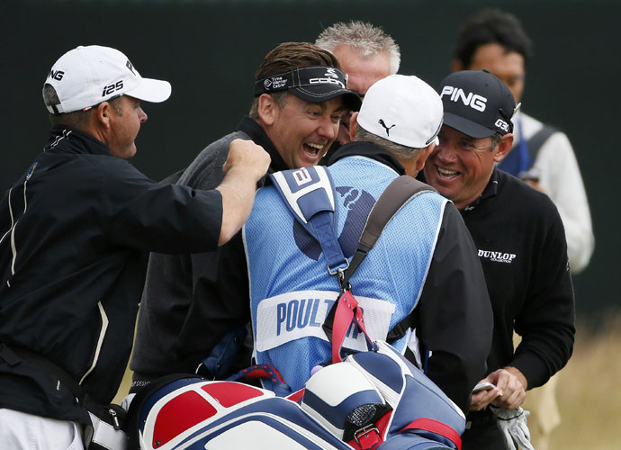 Ian Poulter (middle) and Lee Westwood laugh with Poulter's caddie Terry Mundy during their Monday practice round.